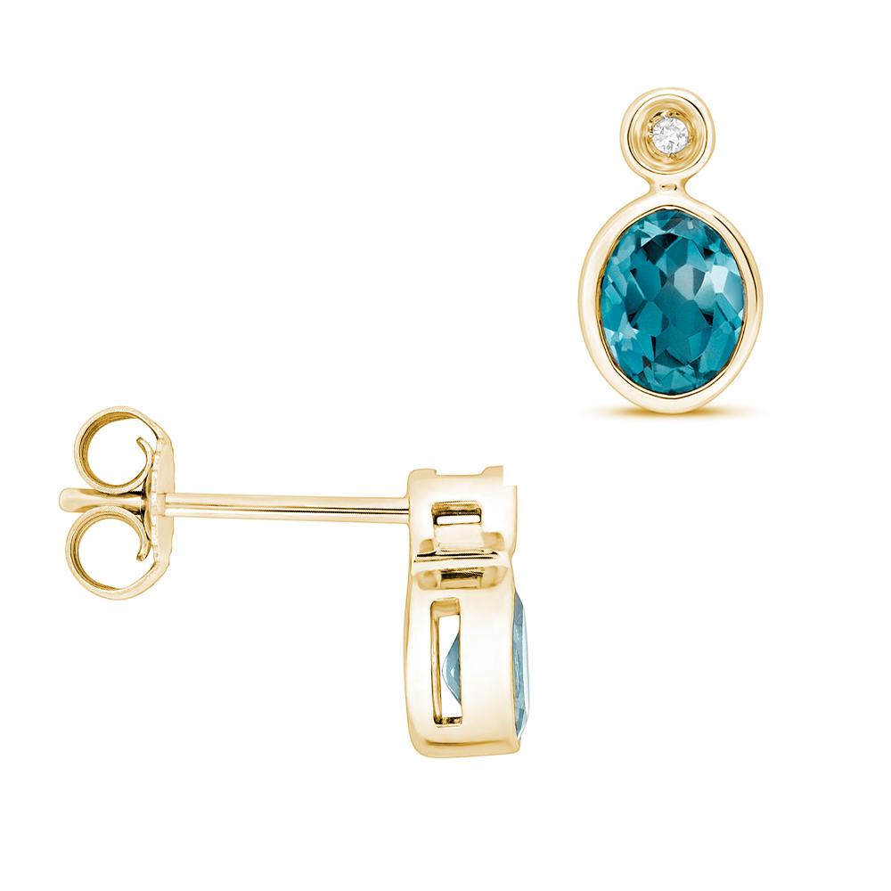 Oval Shape Drop Diamond and 5 X 4mm Blue Topaz Gemstone Earrings