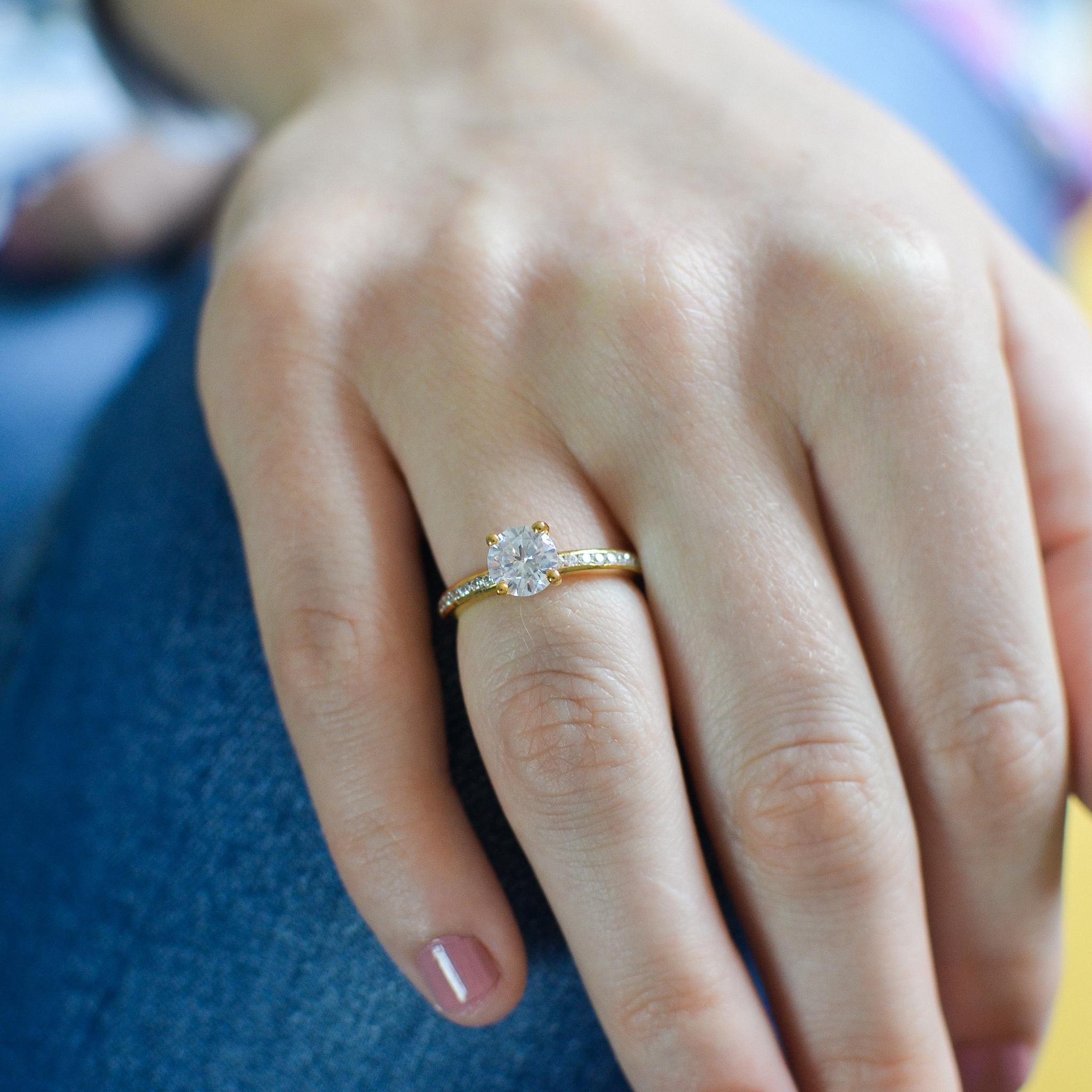 Classic Channel Setting Diamonds Side Stone Diamond Engagement Rings