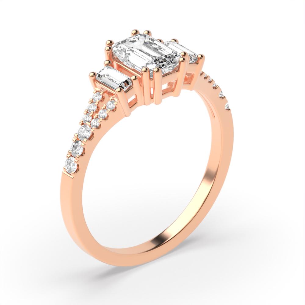 Split Shoulder Emerald Diamond Trilogy Engagement Rings