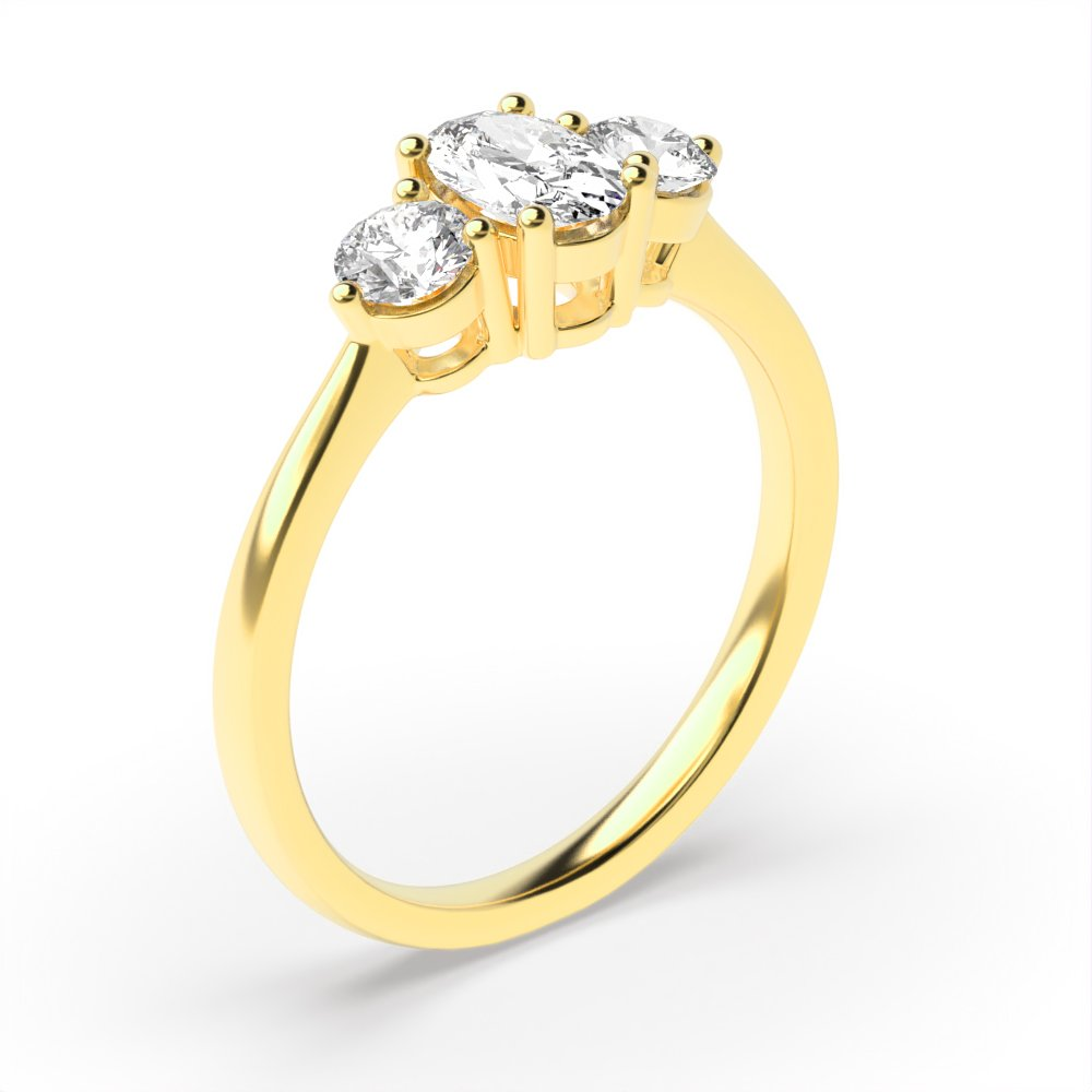 4 Prong Setting Oval Trilogy Diamond Rings in Yellow Gold